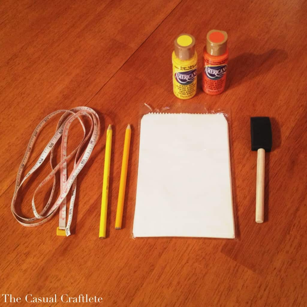 Supplies to make candy corn treat bags