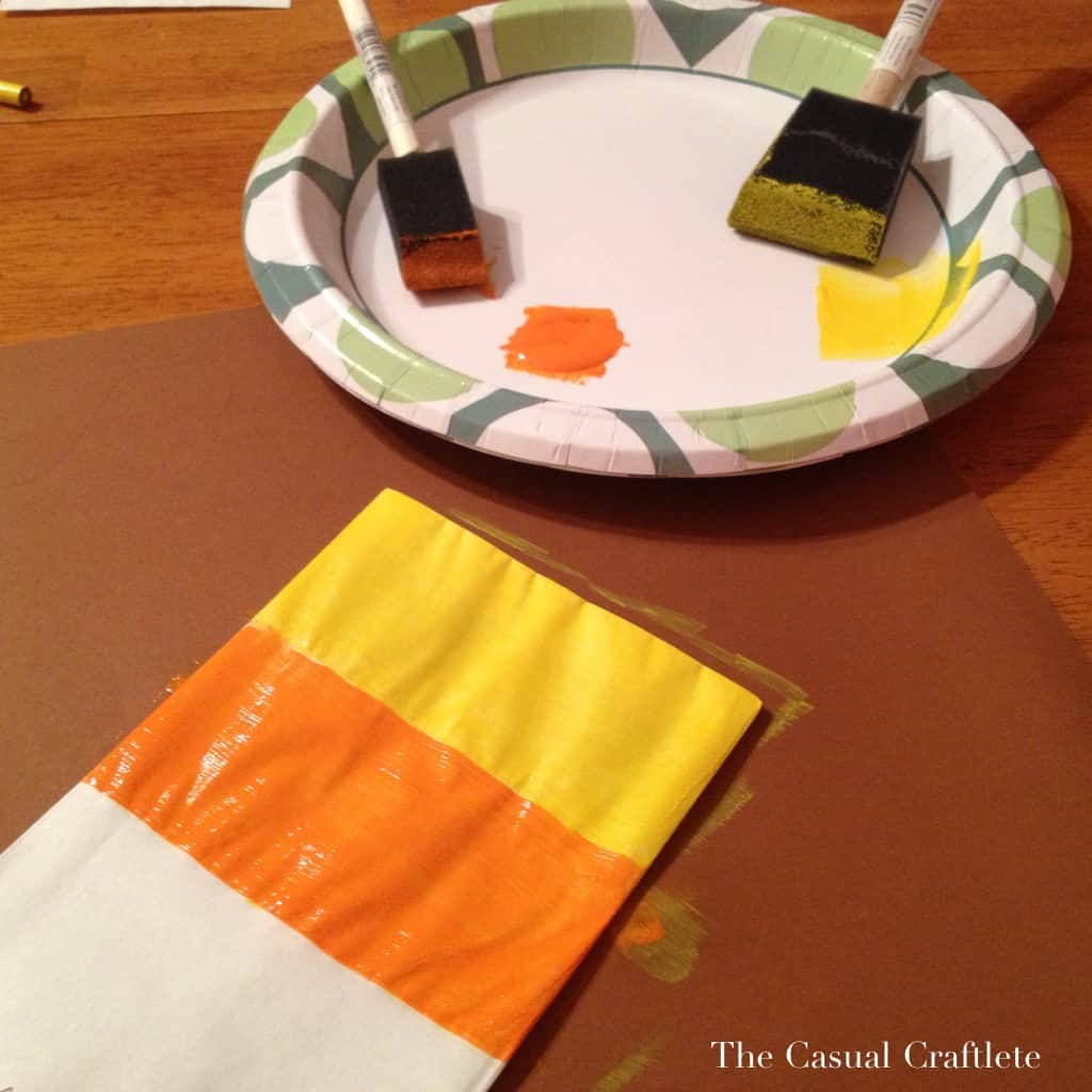 Painting a candy corn treat bag