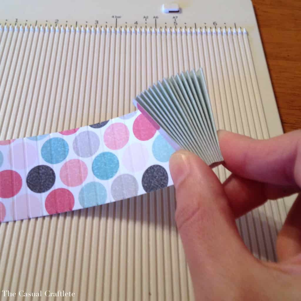 How to make a paper rosette using a scoring board
