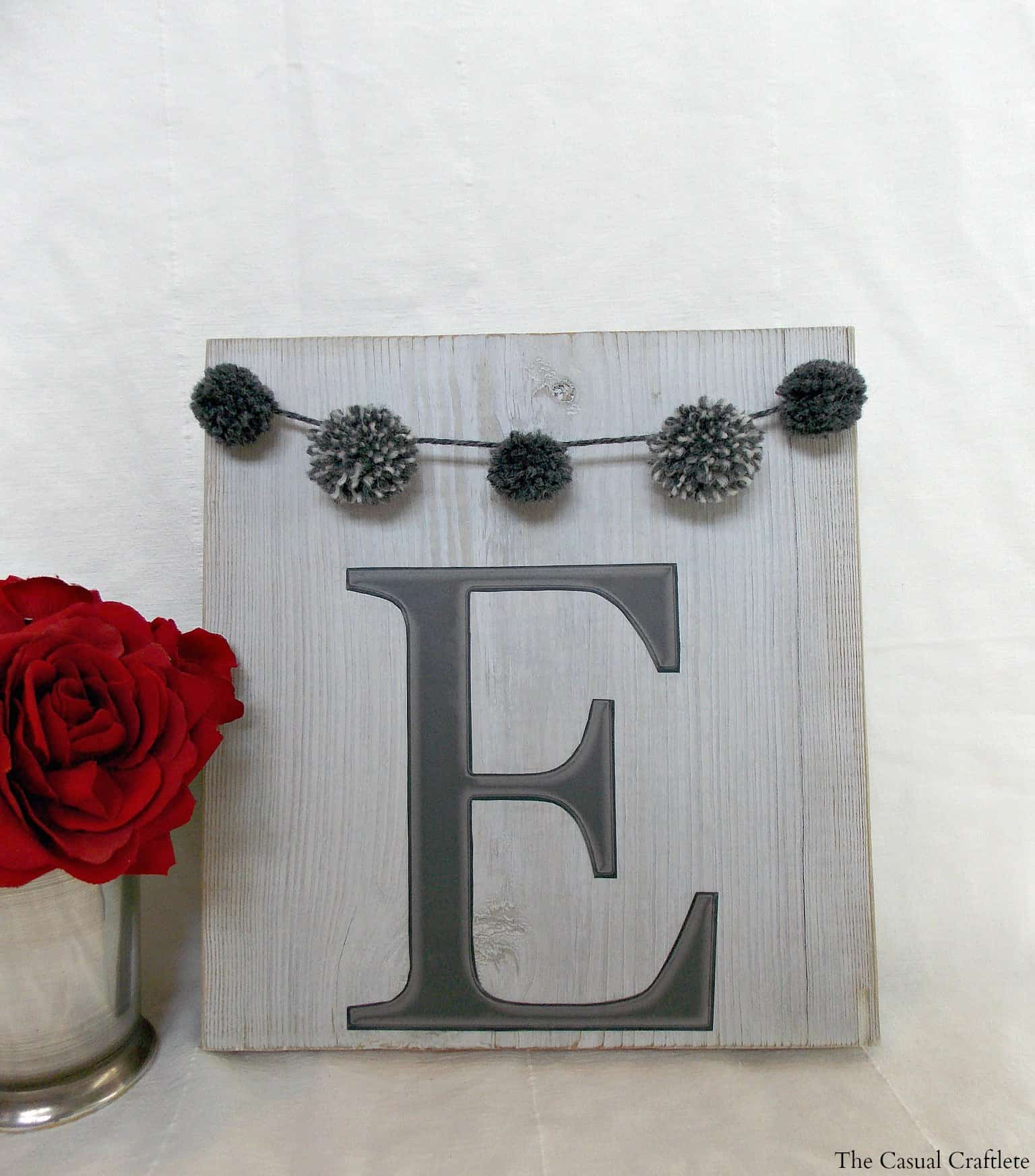 DIY Monogram Wood Plaque with pom pom garland