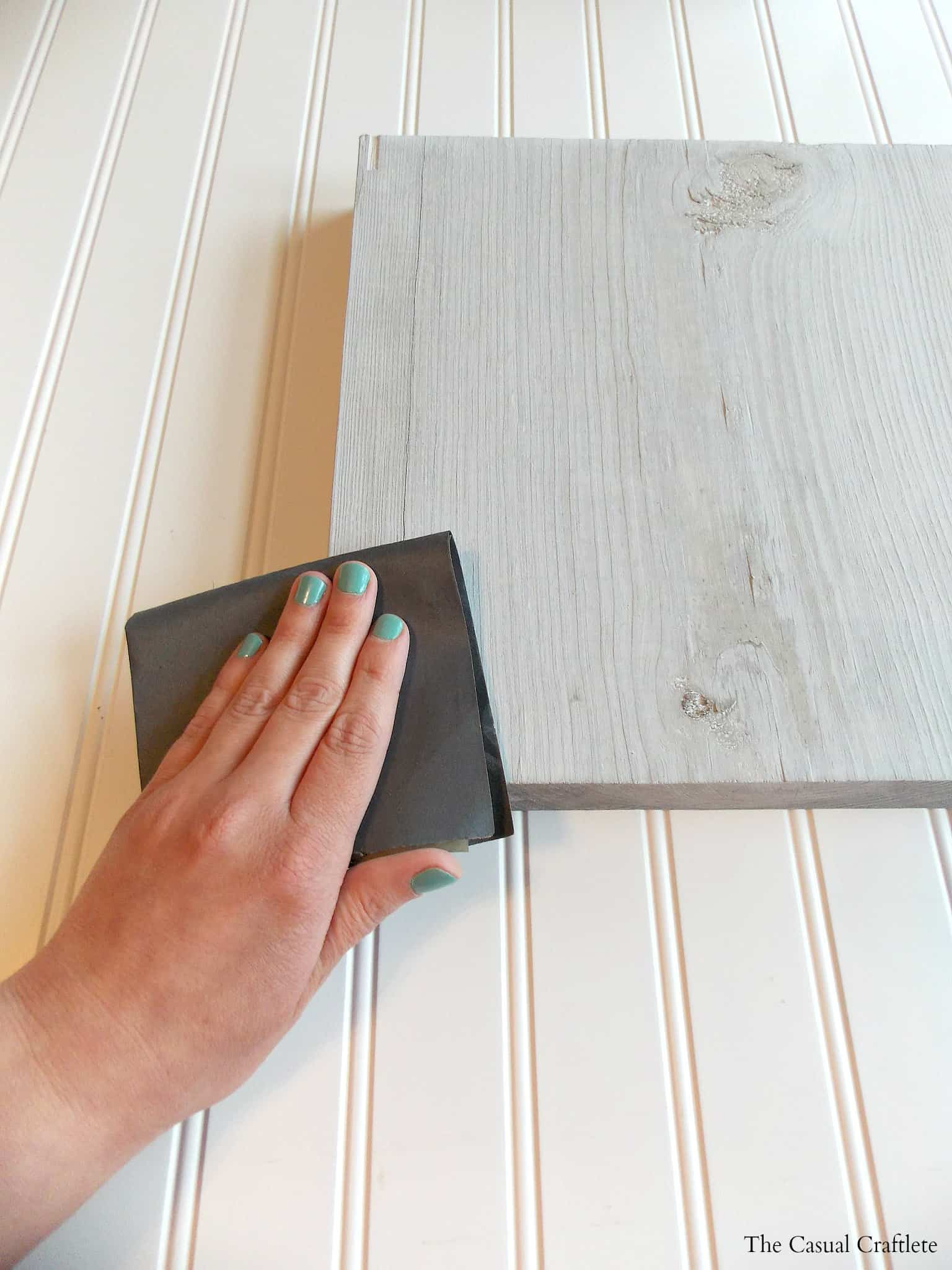Using sandpaper on painted wood for a rustic look
