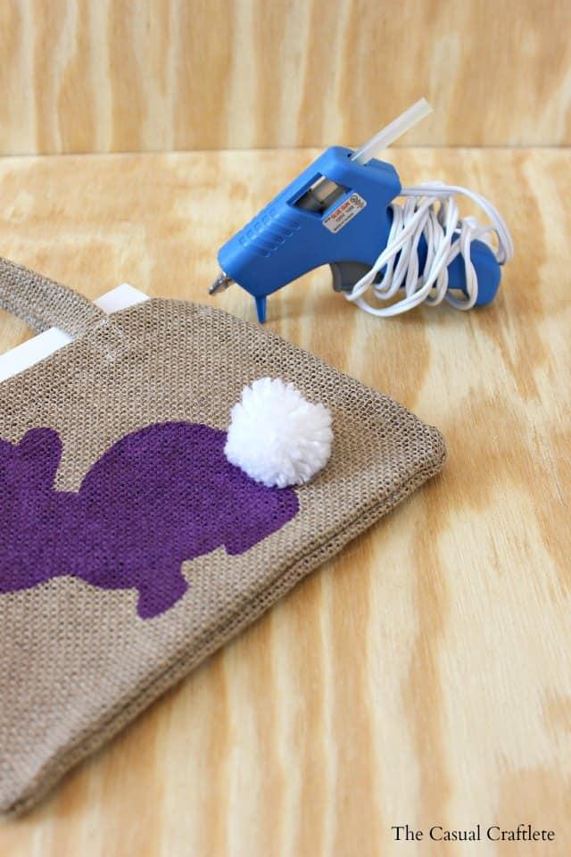 How to make and hot glue a pom pom to burlap