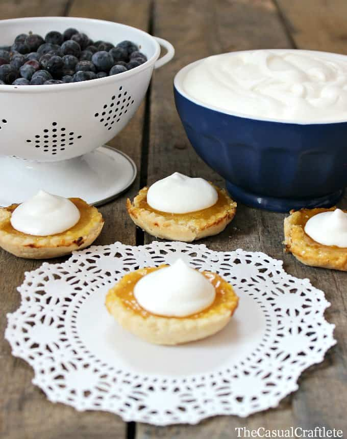 Mini Lemon Tarts with fresh blueberries and whipped cream