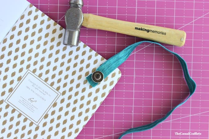 Use eyelets to create an elastic band closure notebook