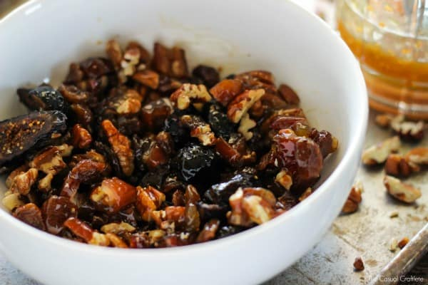 BAKED BRIE with figs, dates, golden raisins, pecans & maple is an easy to make and delicious appetizer recipe. Great for parties!