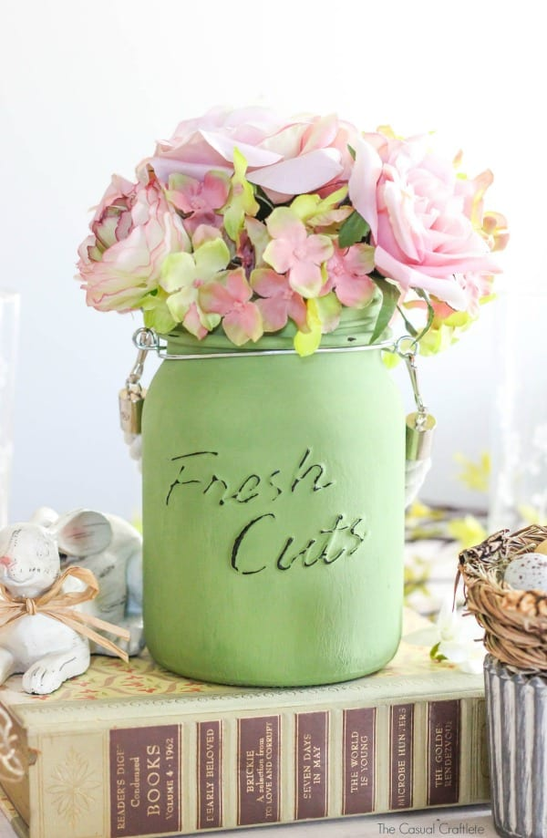Create this Simple Easter Tablescape Decor using glass jars and chalky finish paint for glass. These beautiful neutral colors will brighten the home for spring.