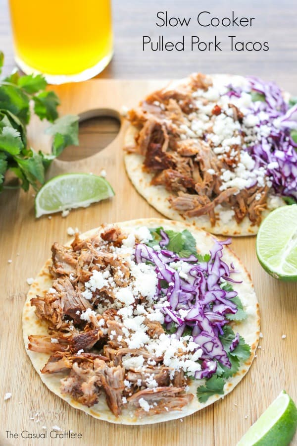 Slow Cooker Pulled Pork Tacos - cooked low and slow, these pork tacos are tender and juicy. Made with a delicious blend of spices and fresh vegetables!