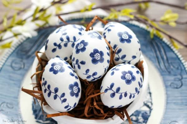Blue and White Paper Napkin Eggs - give a porcelain china look to Easter eggs by decoupaging paper napkins to craft eggs. So easy and will last.