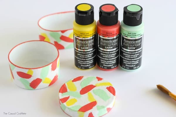 DIY Mini Trinket Boxes - use paint to add pretty brush strokes to paper mache boxes and glass knobs for pulls. Great gift idea for Mother's Day!