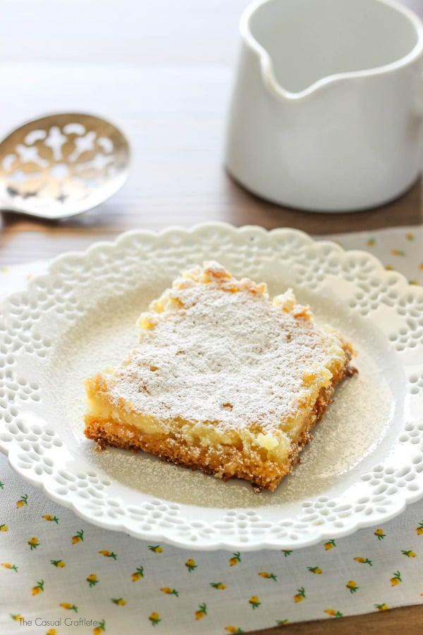 Gooey Butter Cake Bars - made with cream cheese, yellow cake mix, powdered sugar, and lots of butter, this is seriously the best dessert recipe ever!