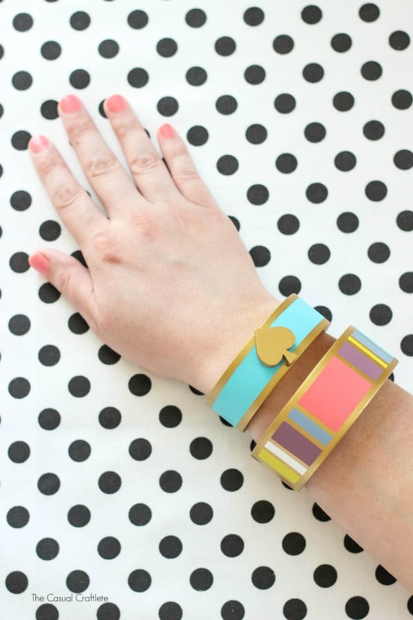 DIY Kate Spade Inspired Bangles - an easy and elegant jewelry craft made using wooden bangle bracelets and paint. Get the look of a designer bangle cheap.