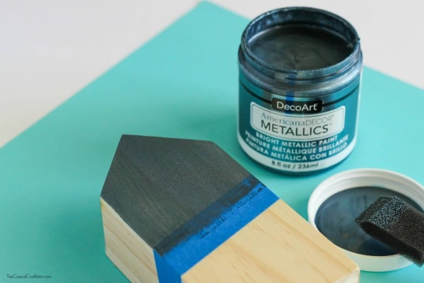 Create a contemporary Metallic and Wood Pencil Holder using a pre-made wooden block and metallic paint. This would make a great Father's Day gift idea!