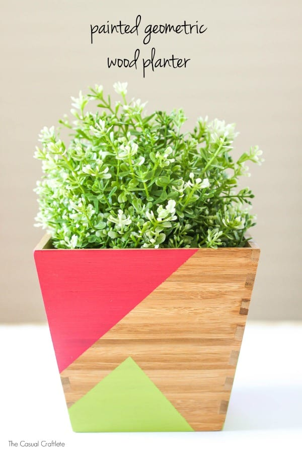 Painted Geometric Wood Planter - add pops of color and character to a plain wood planter by painting easy geometric shapes using outdoor paint.