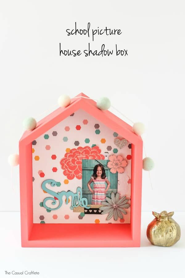 School Picture House Shadow Box - create a fun way to display your kids' school picture by making a scrapbook layout and placing it inside a cute house shadow box. Add lots of embellishments for flair.