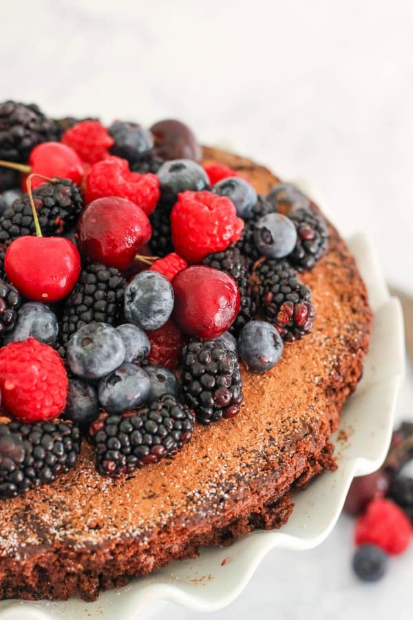 Single Layer Chocolate Cake with Fresh Berries - easy homemade chocolate cake recipe topped with fresh berries that are in season.