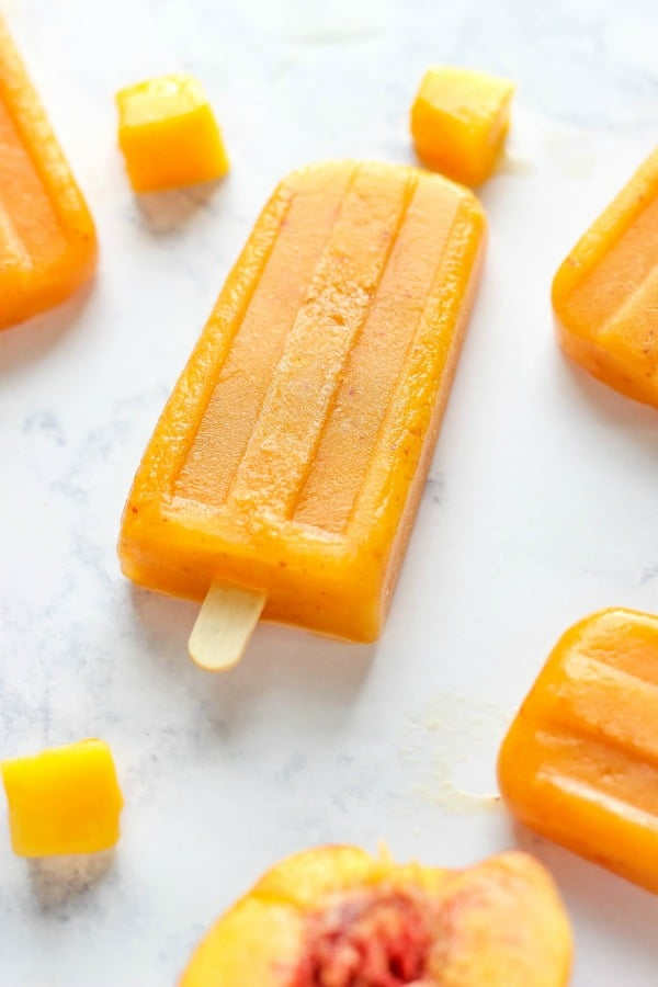 These icy Fresh Peach Mango Popsicles are easy to make with ripened peaches and frozen mango. They are they perfect peach treat.