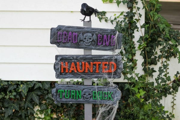 Create these Haunted Halloween Signs to display in your front yard using pre-made foam signs and paint. Its a creepy way to greet your Halloween guests.