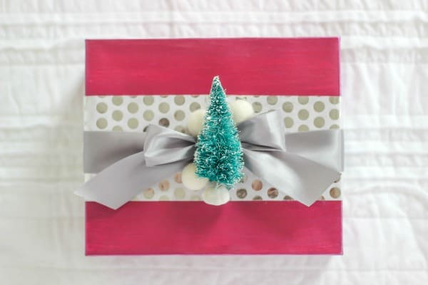 Create beautiful and trendy Metallic and Decoupage Gift Wrap with just a couple of steps. A handmade gift wrapped present truly makes it extra special.