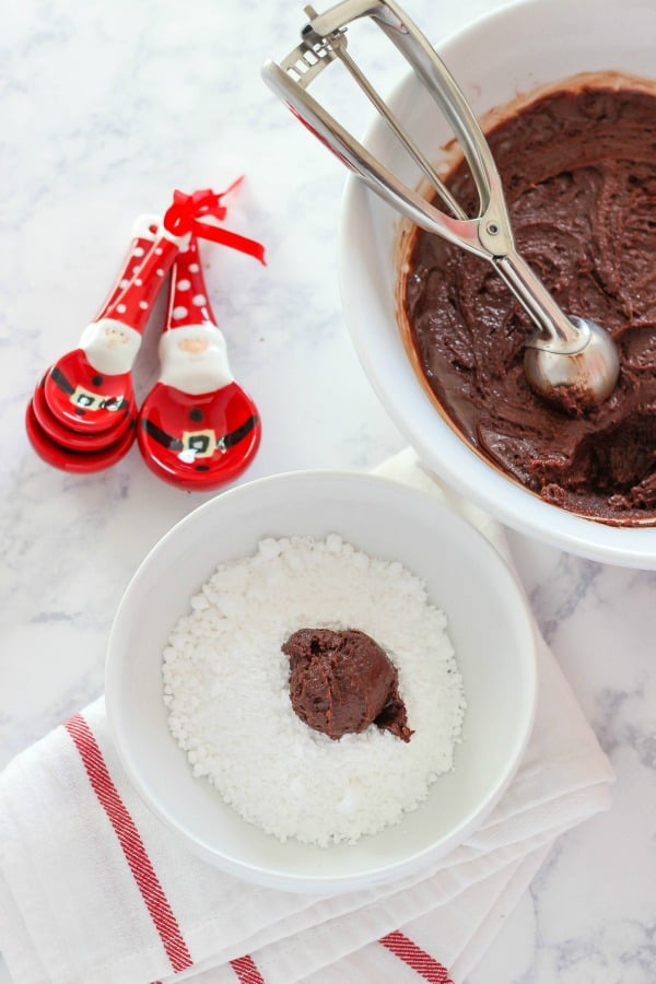 These Chocolate Peppermint Kiss Crinkle Cookies are a classic crinkle cookie recipe topped with a peppermint kiss making it a delicious holiday cookie.