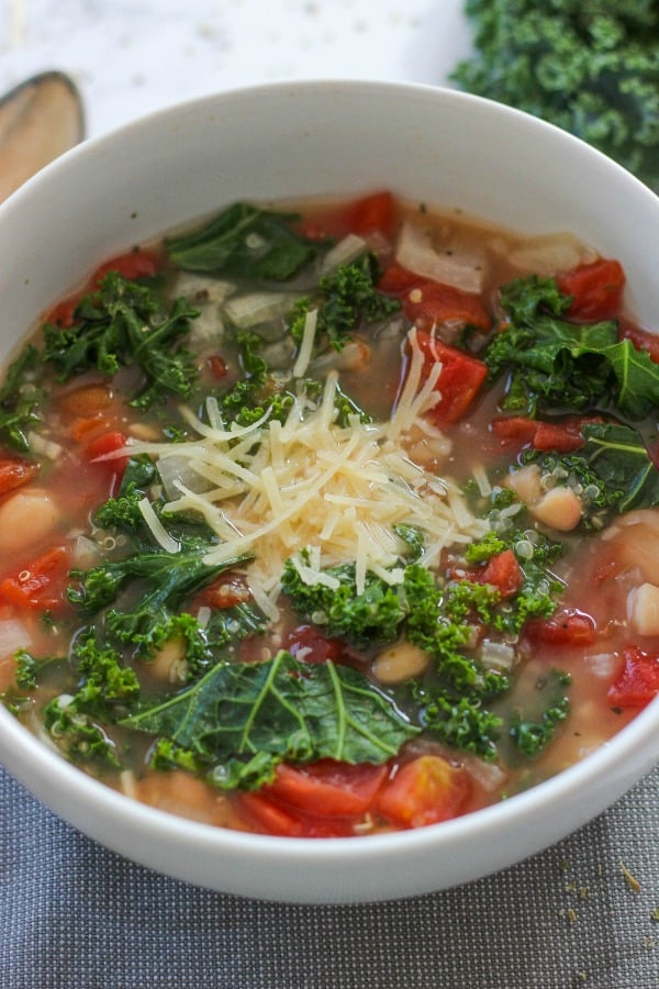 Slow Cooker Italian White Bean and Kale Soup is a delicious and easy to make hearty meal with flavorful Italian seasonings.