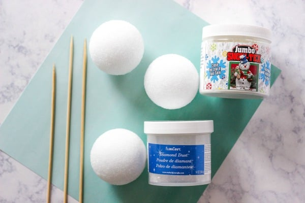 Learn How to Make Sparkle Snow Texture Balls in two steps with less than 5 supplies. These snowballs are great for decorating your home for the holidays.