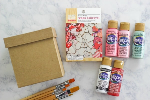 Create an easy DIY Painted Valentine Treat Box for giving chocolates, candy, and treats to your loved ones on Valentine's Day.