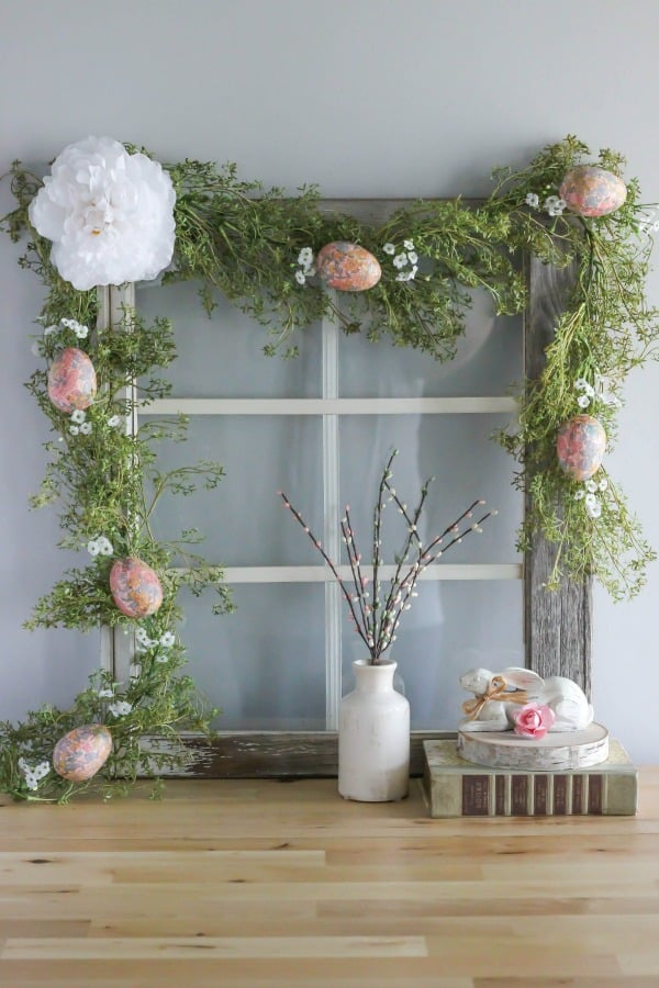 Create your own DIY Decoupage Easter Egg Garland using foam eggs and paper napkins. This beautiful garland can be displayed in your home all spring.
