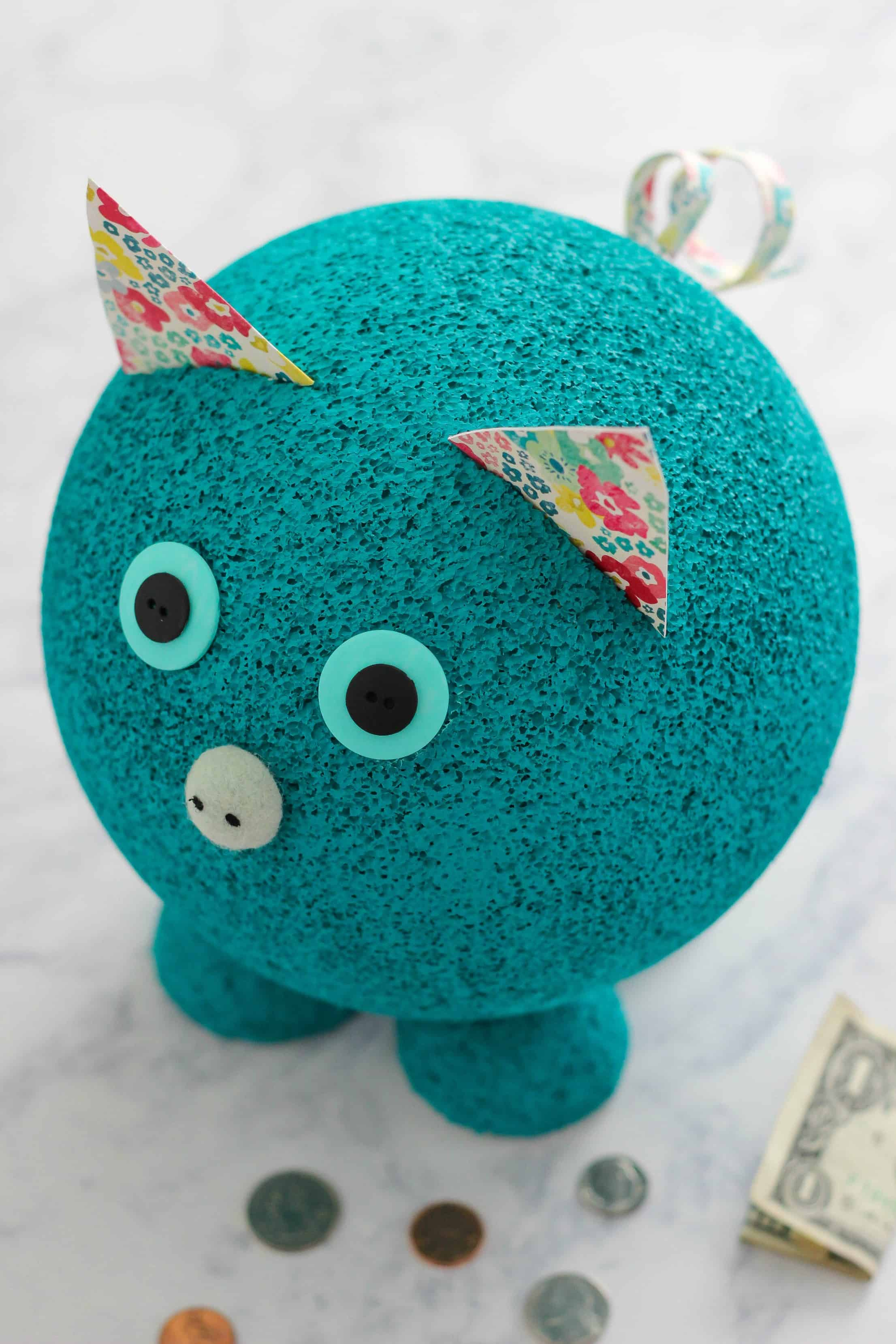Foam Piggy Bank Learning Activity is a fun DIY craft to teach children the importance of money and how to make correct change.
