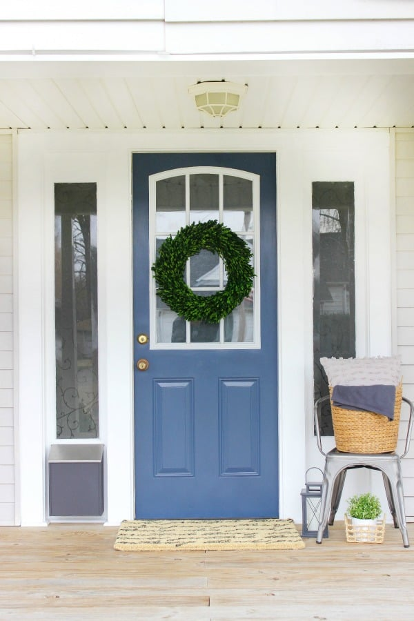 Easy and Inexpensive Front Porch Mini Makeover using paint and updated modern decor. Refresh your porch with just a few easy tips.