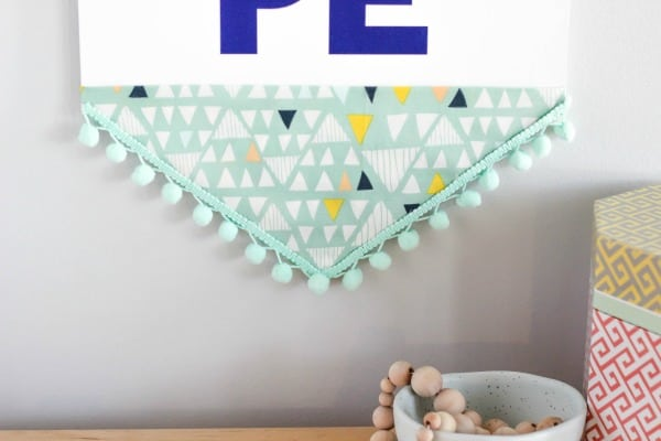 Create a DIY Hope Wall Hanging Banner with fun craft materials that can be customized for your space. Easy to make and trendy wall art.