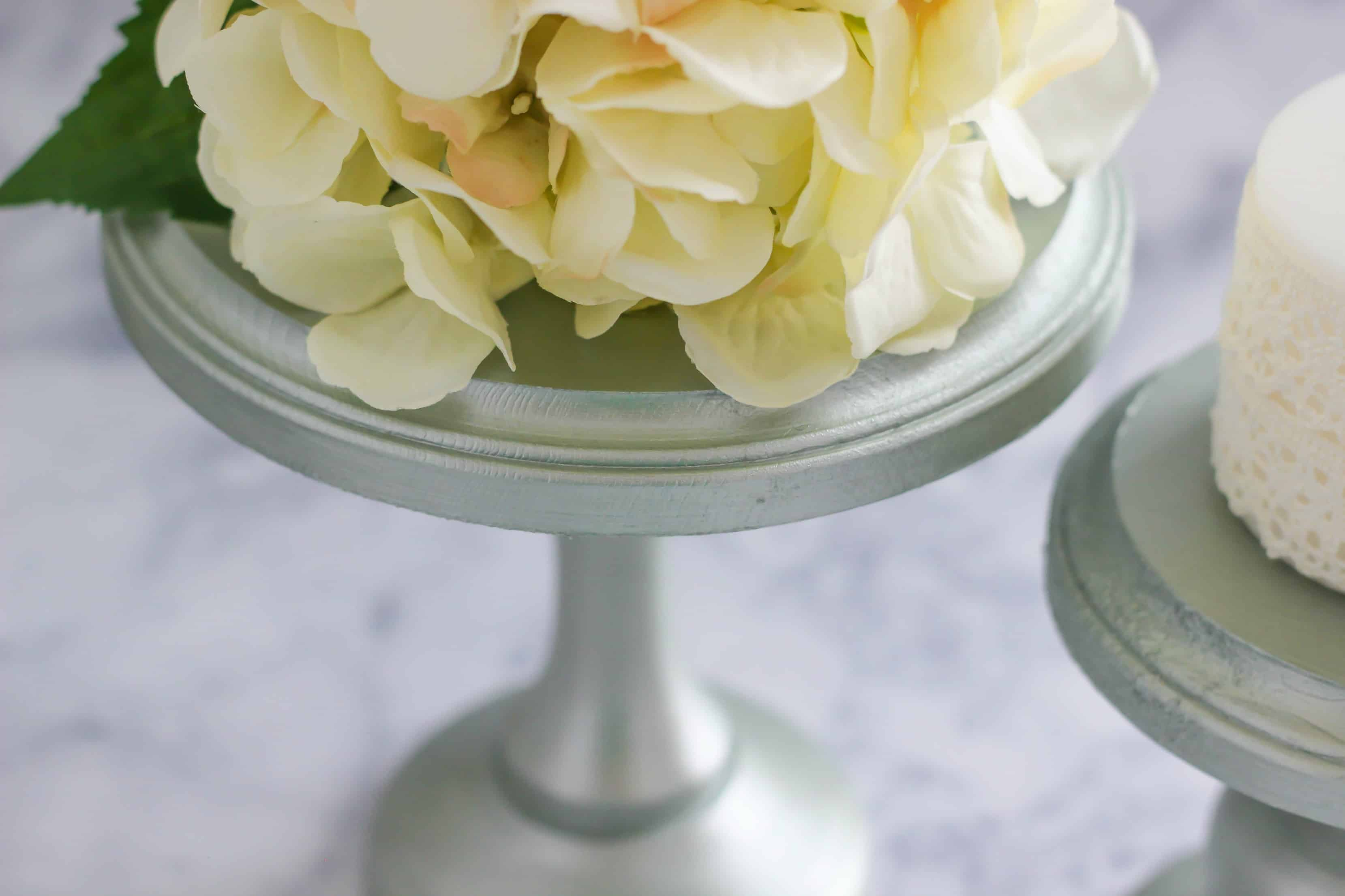 Make a simple and easy DIY Wooden Metallic Paint Stand Centerpiece for an elegant summer wedding or party. You can use the stand to display a cake and more!