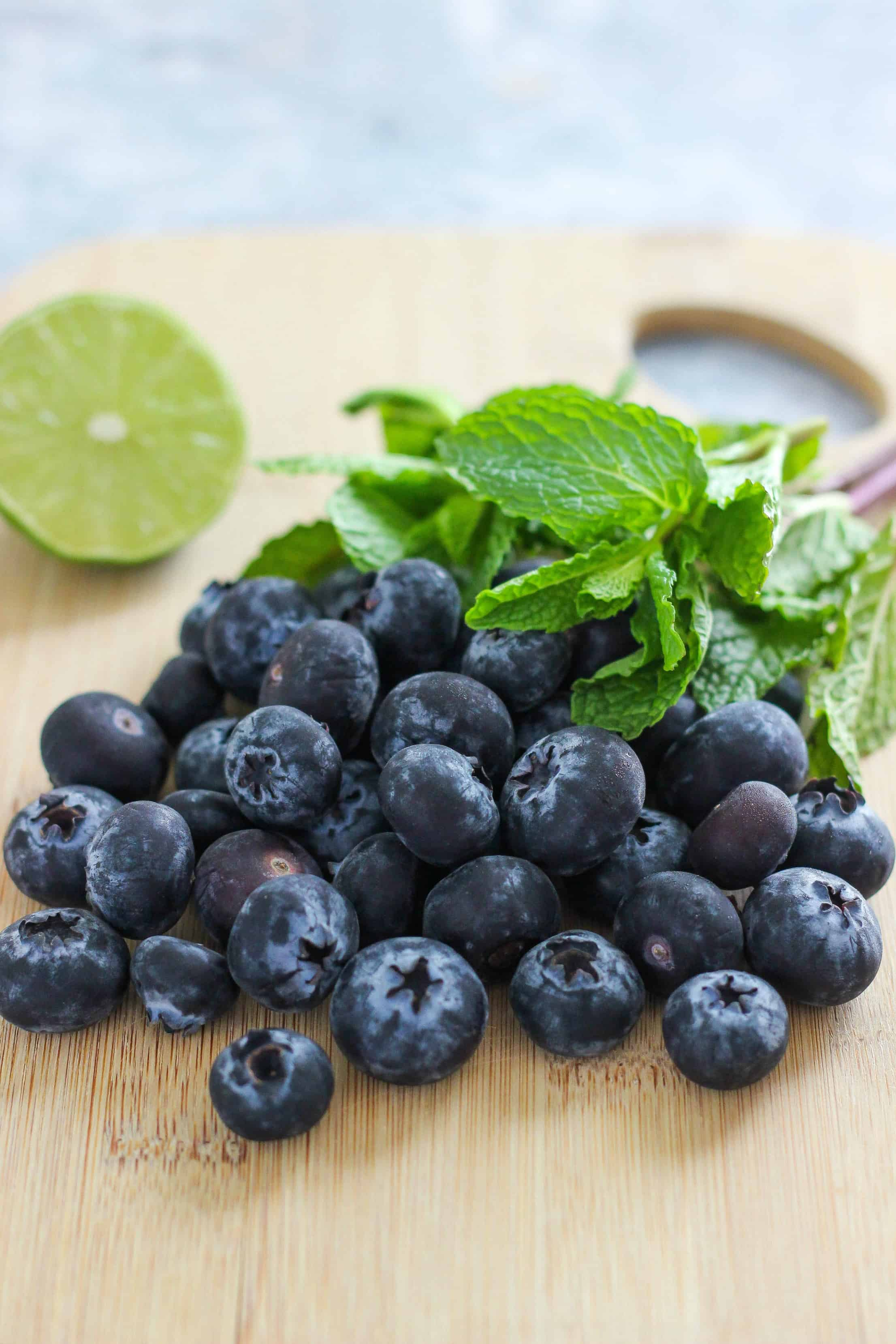 Enjoy a refreshing Blueberry Bourbon Summer Smash cocktail made with fresh blueberries, mint, lime juice, simple syrup, and bourbon.
