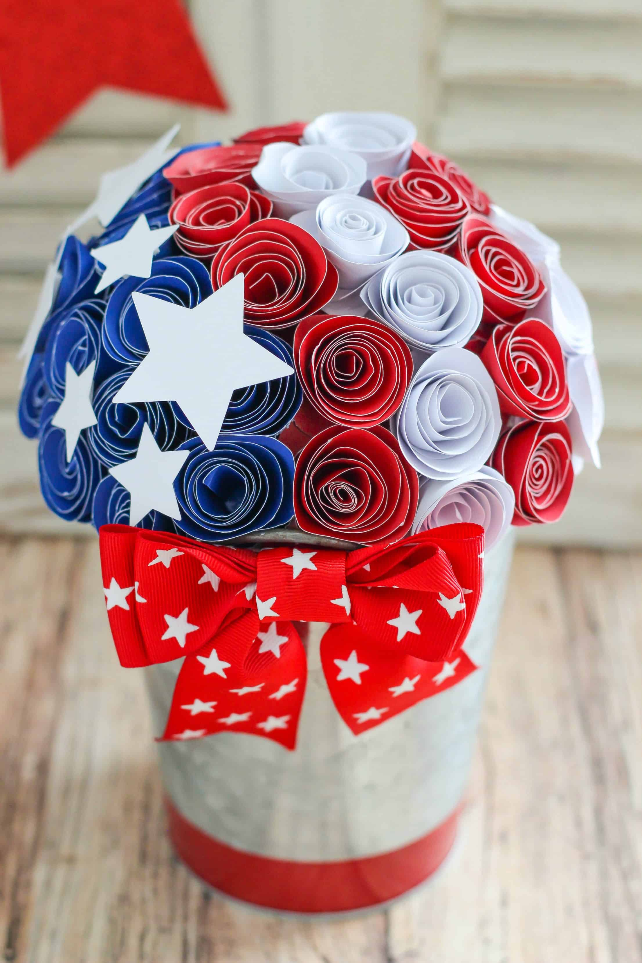 Create this Red, White and Blue Paper Flower Centerpiece with inexpensive supplies and easy steps for your holiday entertaining.