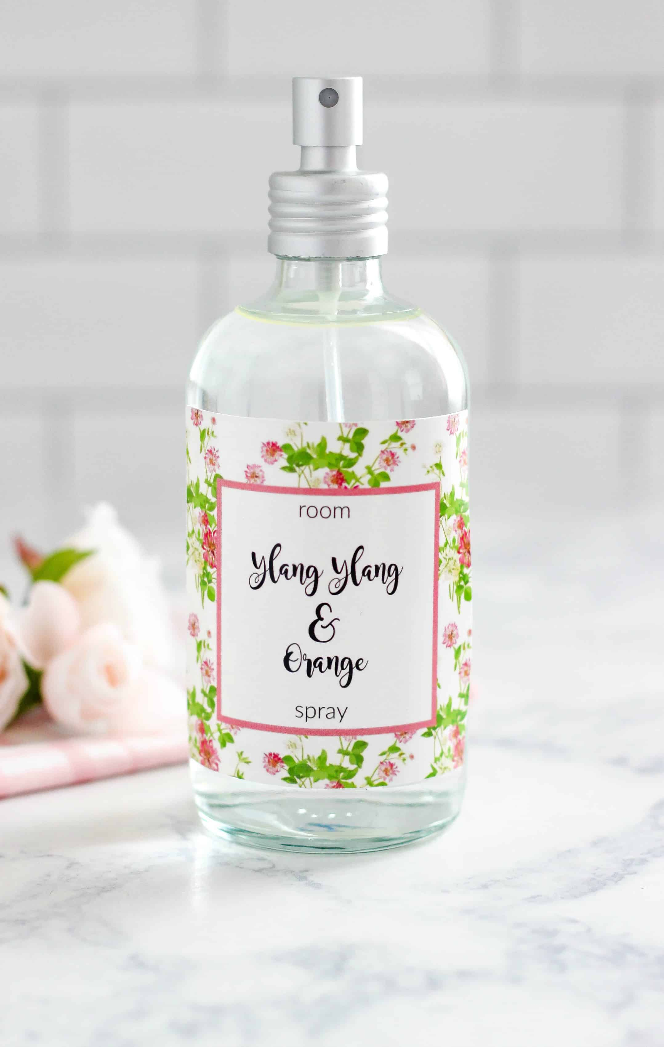 Easy to make 4 ingredient Ylang Ylang and Orange Room Spray is a natural way to freshen up a room. Plus a free printable label for a gift.