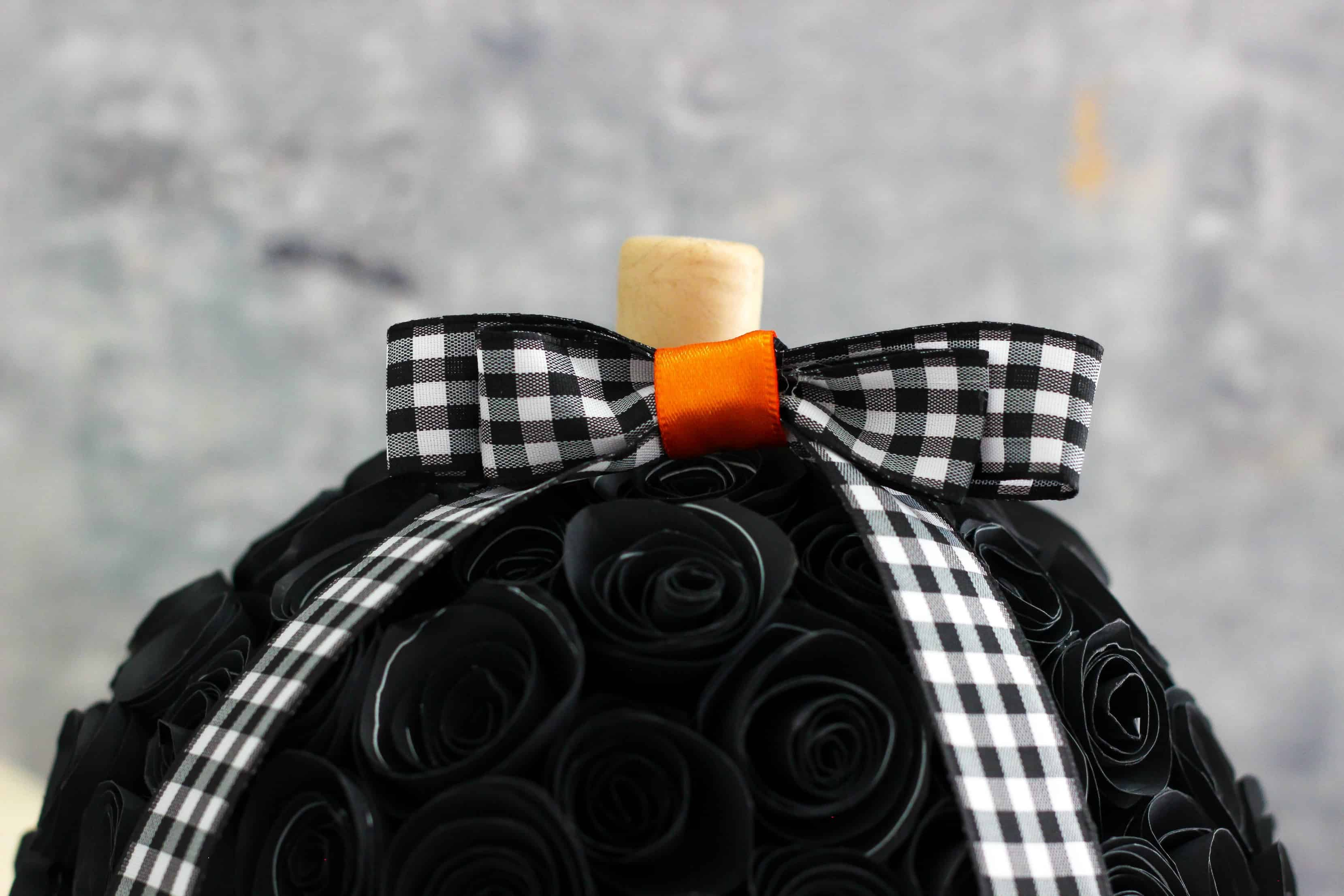 Make your own Rolled Paper Flower Pumpkin for Halloween using inexpensive and simple craft materials.